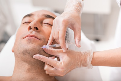 Man Having Anti-wrinkle Injection in chin