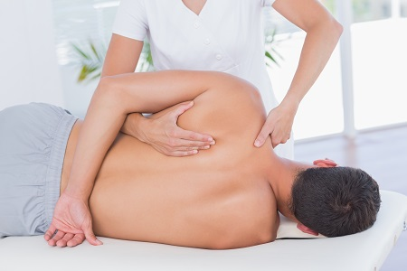Physiotherapist treating male client